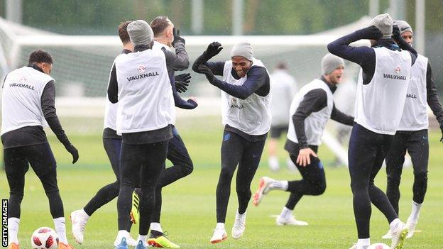 England players joking with each other during a training session in Saint Petersburg