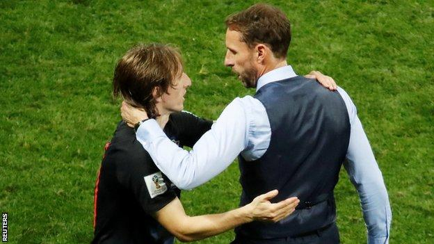 Luka Modric is congratulated by England manager Gareth Southgate