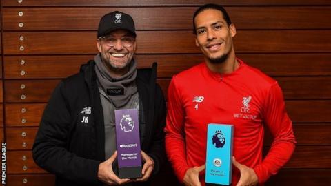 Liverpool manager Jurgen Klopp and defender Virgil van Dijk hold their trophies