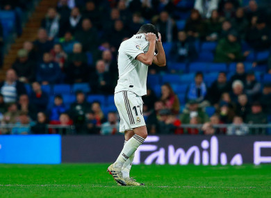 Real Madrid's Lucas Vazquez reacts to being sent off.